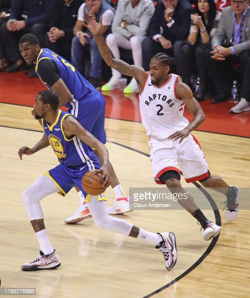 Kevin Durant of the Golden State Warriors eludes Kawhi Leonard of the Toronto Raptors during Game Five of the 2019 NBA Finals at Scotiabank Arena on...