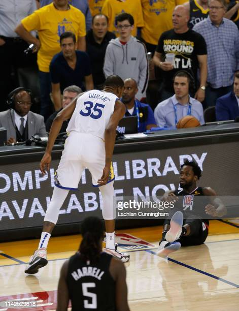 Kevin Durant of the Golden State Warriors exchanges words with Patrick Beverley of the LA Clippers during Game One of the first round of the 2019 NBA...