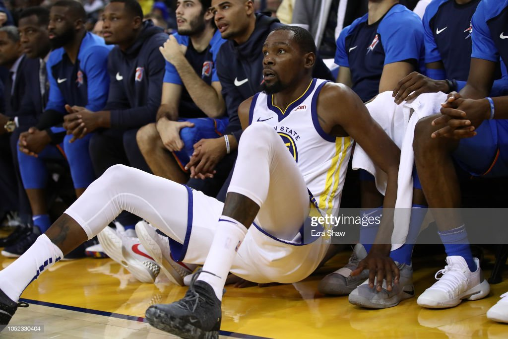 2f79115ac44c Kevin Durant of the Golden State Warriors falls into the Oklahoma ...