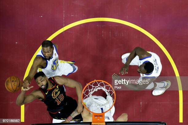 Kevin Durant of the Golden State Warriors fights for a rebound with Tristan Thompson of the Cleveland Cavaliers during Game Four of the 2018 NBA...
