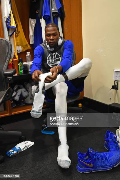 Kevin Durant of the Golden State Warriors gets ready in the locker room before Game One of the 2017 NBA Finals against the Cleveland Cavaliers on...