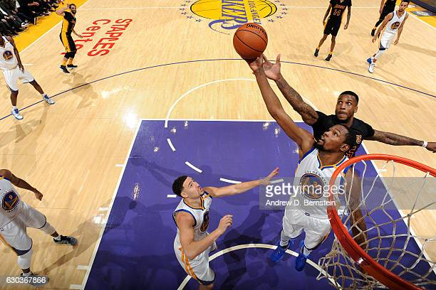 Kevin Durant of the Golden State Warriors goes for the rebound against Thomas Robinson of the Los Angeles Lakers on November 25 2016 at STAPLES...
