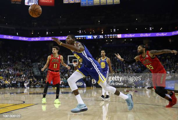 Kevin Durant of the Golden State Warriors goes past DeAndre' Bembry of the Atlanta Hawks to get the ball at ORACLE Arena on November 13 2018 in...