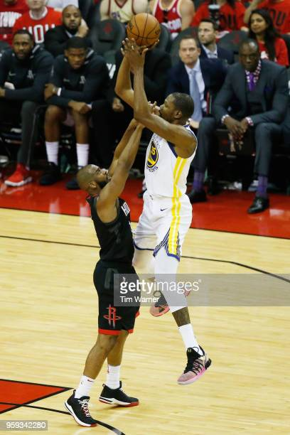 Kevin Durant of the Golden State Warriors goes up against Chris Paul of the Houston Rockets in the second half of Game Two of the Western Conference...