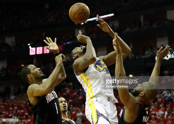 Kevin Durant of the Golden State Warriors goes up against Chris Paul and Trevor Ariza of the Houston Rockets in the third quarter of Game Five of the...