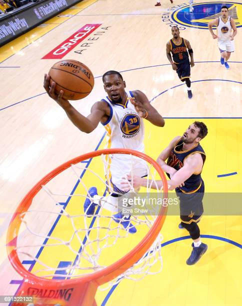Kevin Durant of the Golden State Warriors goes up for a basket against Kevin Love of the Cleveland Cavaliers in Game 1 of the 2017 NBA Finals at...