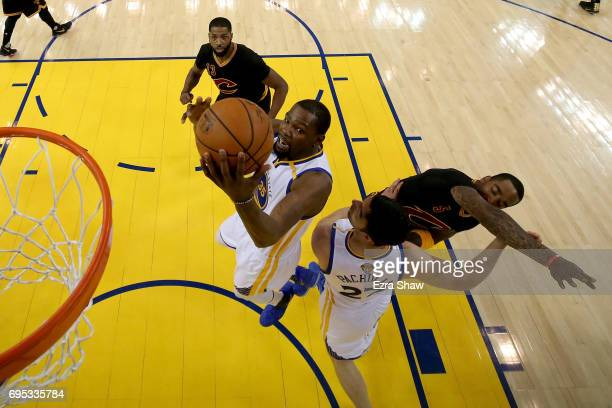 Kevin Durant of the Golden State Warriors goes up for a basket against the Cleveland Cavaliers in Game 5 of the 2017 NBA Finals at ORACLE Arena on...