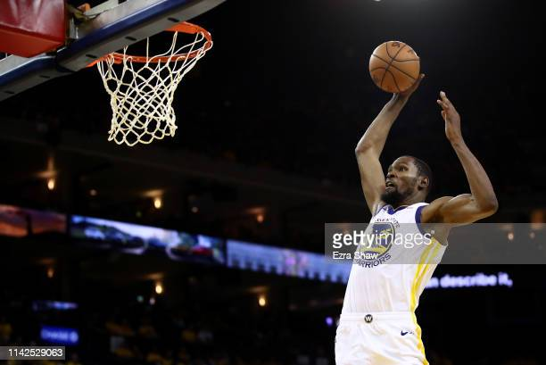 Kevin Durant of the Golden State Warriors goes up for a dunk against the LA Clippers during Game One of the first round of the 2019 NBA Western...