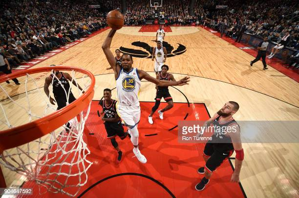 Kevin Durant of the Golden State Warriors goes up for a dunk against the Toronto Raptors on January 13 2018 at the Air Canada Centre in Toronto...