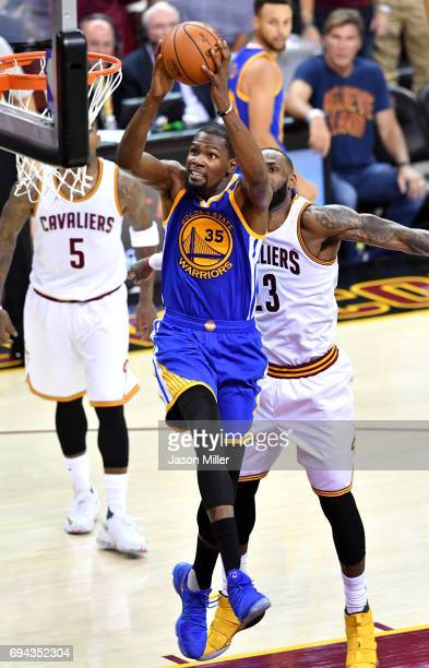 Kevin Durant of the Golden State Warriors goes up for a dunk in the third quarter against LeBron James of the Cleveland Cavaliers in Game 4 of the...