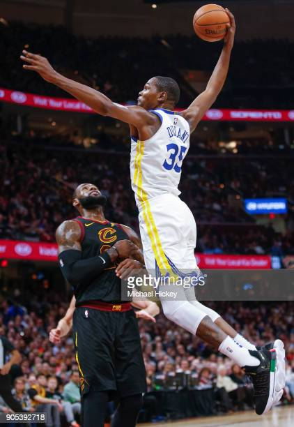 Kevin Durant of the Golden State Warriors goes up for the dunk over LeBron James of the Cleveland Cavaliers at Quicken Loans Arena on January 15 2018...