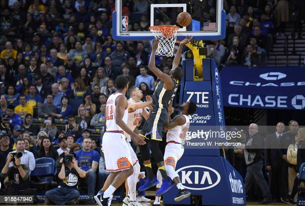 Kevin Durant of the Golden State Warriors goes up to shoot and score over Alex Len and Troy Daniels of the Phoenix Suns during an NBA basketball game...