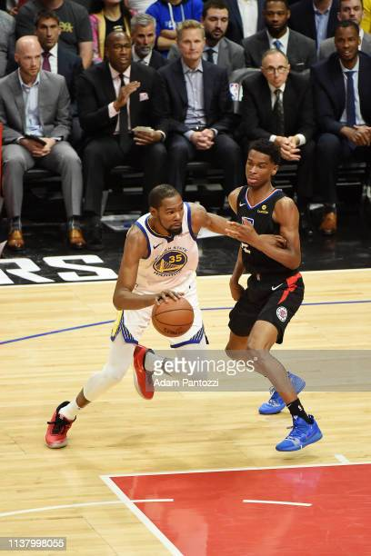 Kevin Durant of the Golden State Warriors handles the ball against the LA Clippers during Game Three of Round One of the 2019 NBA Playoffs on April...