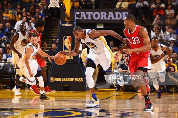 Kevin Durant of the Golden State Warriors handles the ball against the Los Angeles Clippers during a preseason game on October 4 2016 at ORACLE Arena...