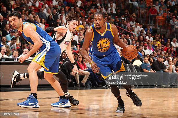 Kevin Durant of the Golden State Warriors handles the ball against the Miami Heat on January 23 2017 at American Airlines Arena in Miami Florida NOTE...