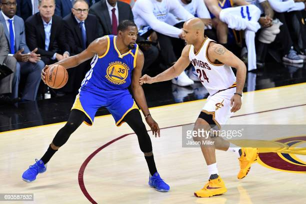 Kevin Durant of the Golden State Warriors handles the ball against Richard Jefferson of the Cleveland Cavaliers in the first half in Game 3 of the...