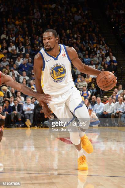 Kevin Durant of the Golden State Warriors handles the ball against the Miami Heat on November 6 2017 at ORACLE Arena in Oakland California NOTE TO...