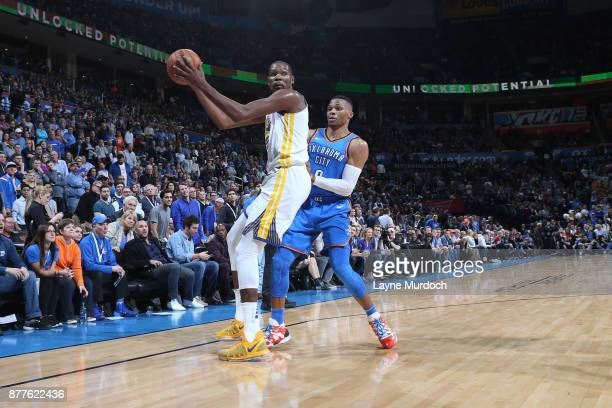 Kevin Durant of the Golden State Warriors handles the ball against Russell Westbrook of the Oklahoma City Thunder on November 22 2017 at Chesapeake...