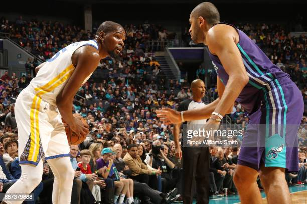 Kevin Durant of the Golden State Warriors handles the ball against the Charlotte Hornets on December 6 2017 at Spectrum Center in Charlotte North...