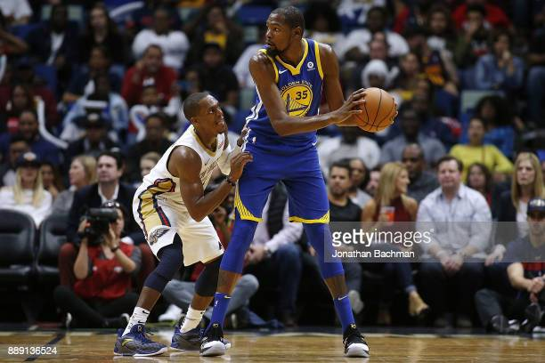 Kevin Durant of the Golden State Warriors handles the ball against Rajon Rondo of the New Orleans Pelicans during the first half of a game at the...