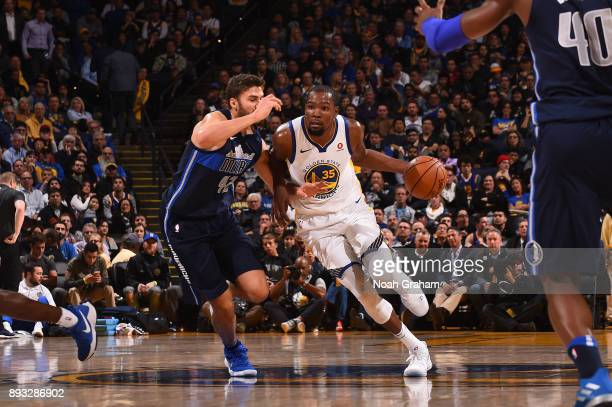 Kevin Durant of the Golden State Warriors handles the ball against the Dallas Mavericks on December 14 2017 at ORACLE Arena in Oakland California...