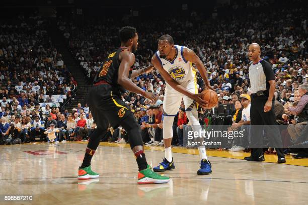 Kevin Durant of the Golden State Warriors handles the ball against Jeff Green of the Cleveland Cavaliers on December 25 2017 at ORACLE Arena in...