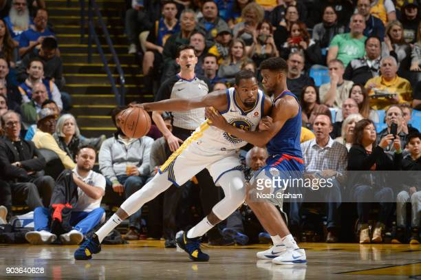 Kevin Durant of the Golden State Warriors handles the ball against the LA Clippers on January 10 2018 at ORACLE Arena in Oakland California NOTE TO...