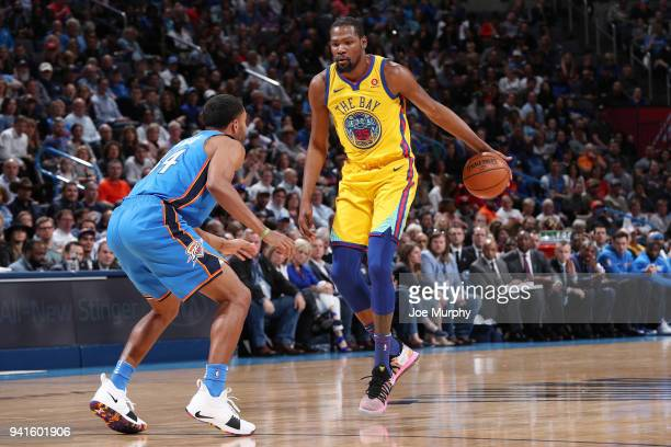 Kevin Durant of the Golden State Warriors handles the ball against Josh Huestis of the Oklahoma City Thunder during the game on April 3 2018 at...