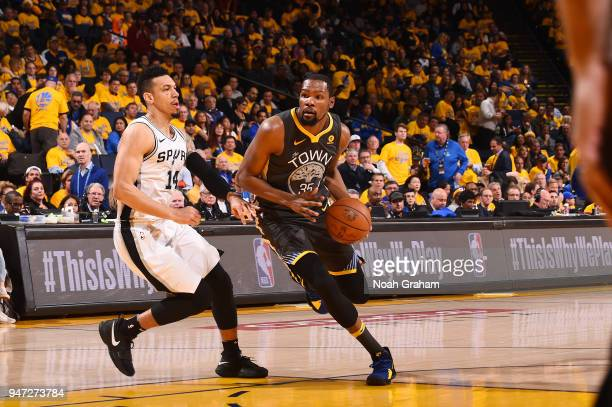 Kevin Durant of the Golden State Warriors handles the ball against the San Antonio Spurs in Game Two of Round One of the 2018 NBA Playoffs on April...