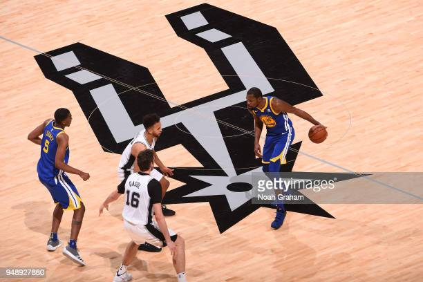Kevin Durant of the Golden State Warriors handles the ball against the San Antonio Spurs in Game Three of Round One of the 2018 NBA Playoffs on April...