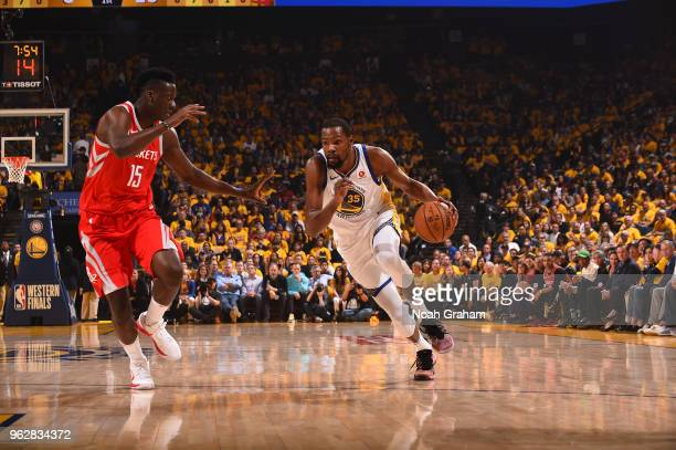 Kevin Durant of the Golden State Warriors handles the ball against the Houston Rockets during Game Six of the Western Conference Finals during the...