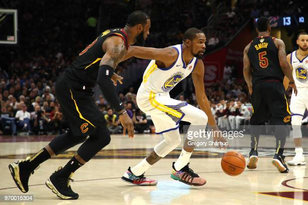 Kevin Durant of the Golden State Warriors handles the ball against LeBron James of the Cleveland Cavaliers in the first quarter during Game Four of...