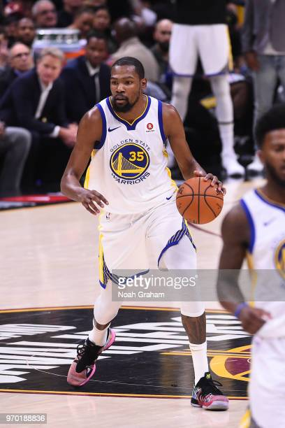 Kevin Durant of the Golden State Warriors handles the ball against the Cleveland Cavaliers during Game Four of the 2018 NBA Finals on June 8 2018 at...