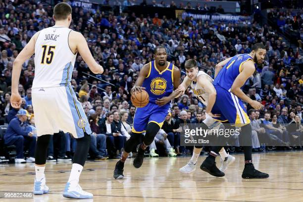 Kevin Durant of the Golden State Warriors handles the ball against the Denver Nuggets on February 13 2017 at the Pepsi Center in Denver Colorado NOTE...