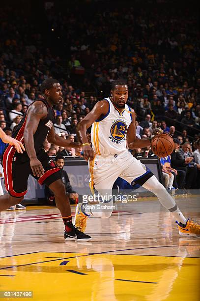 Kevin Durant of the Golden State Warriors handles the ball during a game against the Miami Heat on January 10 2017 at ORACLE Arena in Oakland...