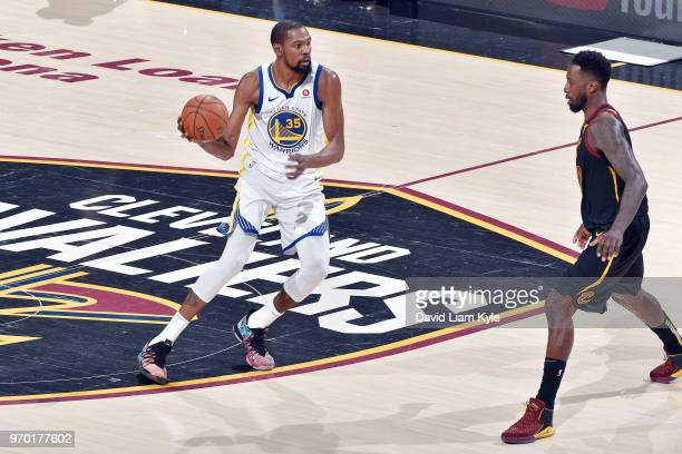 OH Kevin Durant of the Golden State Warriors handles the ball during the game against Tristan Thompson of the Cleveland Cavaliers in Game Four of the...