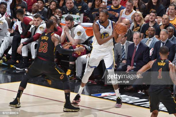 OH Kevin Durant of the Golden State Warriors handles the ball during the game against LeBron James of the Cleveland Cavaliers in Game Four of the...