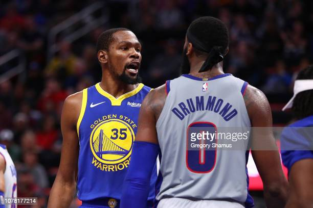 Kevin Durant of the Golden State Warriors has a heated discussion with Andre Drummond of the Detroit Pistons at Little Caesars Arena on December 01...
