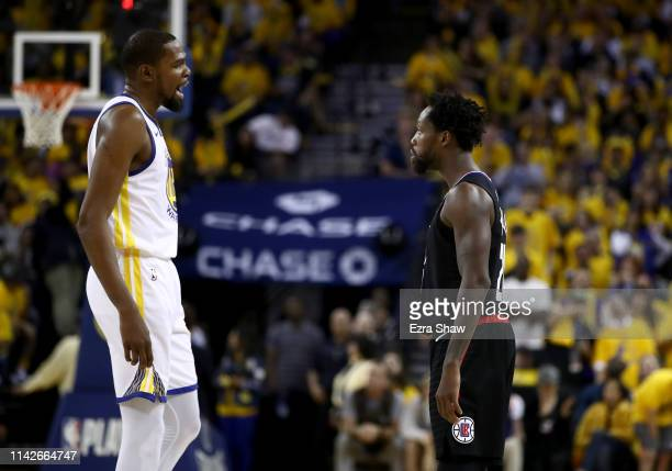 Kevin Durant of the Golden State Warriors has words with Patrick Beverley of the LA Clippers during Game One of the first round of the 2019 NBA...