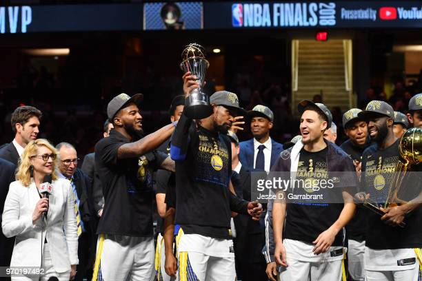Kevin Durant of the Golden State Warriors holds the Bill Russell Finals MVP trophy after defeating the Cleveland Cavaliers in Game Four of the 2018...
