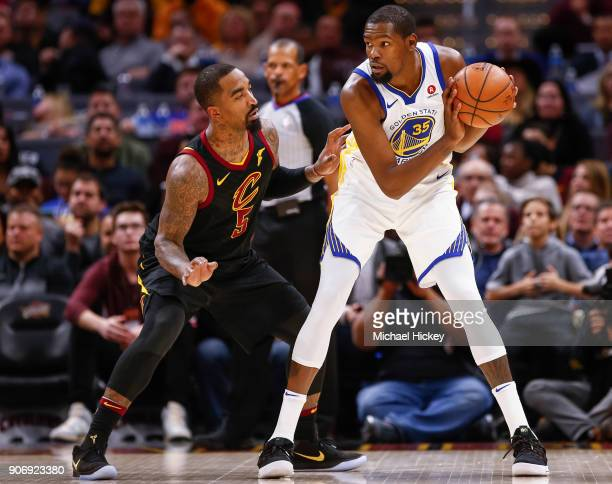 Kevin Durant of the Golden State Warriors holdst the ball against JR Smith of the Cleveland Cavaliers at Quicken Loans Arena on January 15 2018 in...
