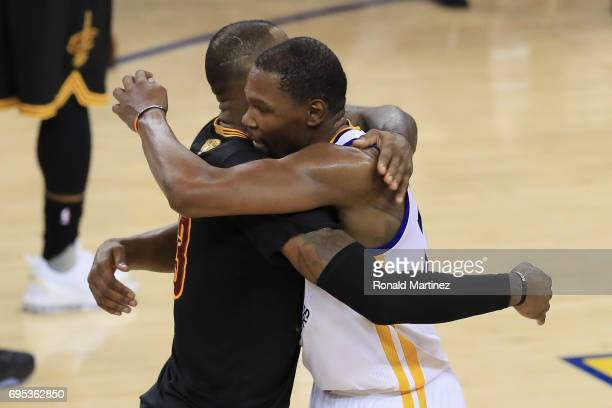 Kevin Durant of the Golden State Warriors hugs LeBron James of the Cleveland Cavaliers after defeating the Cleveland Cavaliers 129120 in Game 5 to...
