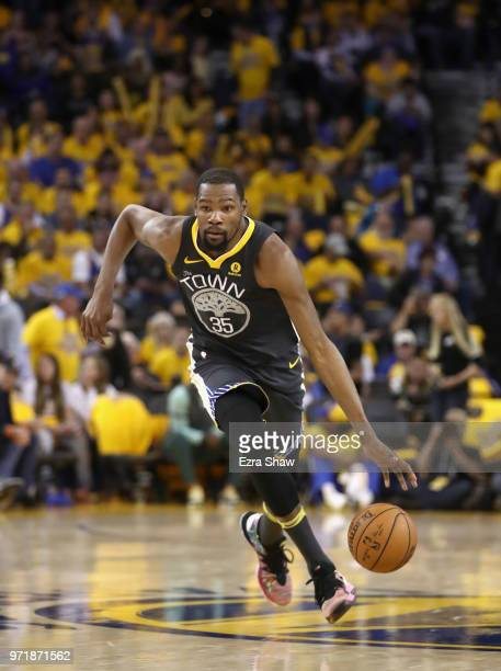 Kevin Durant of the Golden State Warriors in action against the Houston Rockets during Game 4 of the Western Conference Finals at ORACLE Arena on May...