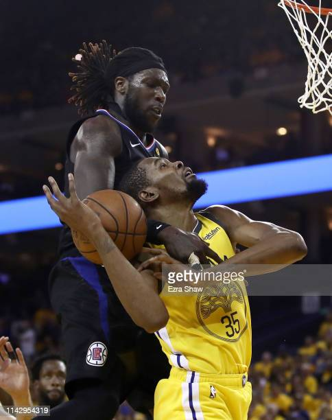 Kevin Durant of the Golden State Warriors is fouled by Montrezl Harrell of the LA Clippers during Game Two of the first round of the 2019 NBA Western...