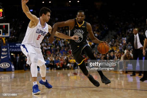 Kevin Durant of the Golden State Warriors is guarded by Danilo Gallinari of the LA Clippers at ORACLE Arena on December 23 2018 in Oakland California...