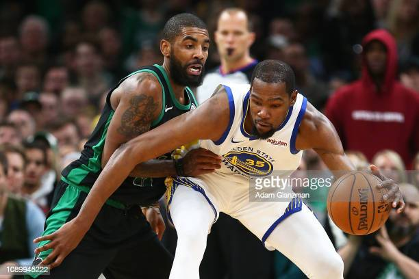Kevin Durant of the Golden State Warriors is guarded by Kyrie Irving of the Boston Celtics during a game at TD Garden on January 26 2019 in Boston...