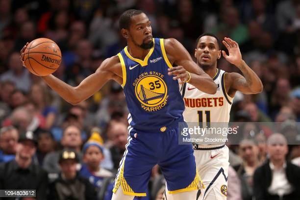 Kevin Durant of the Golden State Warriors is guarded by Monte Morris of the Denver Nuggets at the Pepsi Center on January 15 2019 in Denver Colorado...