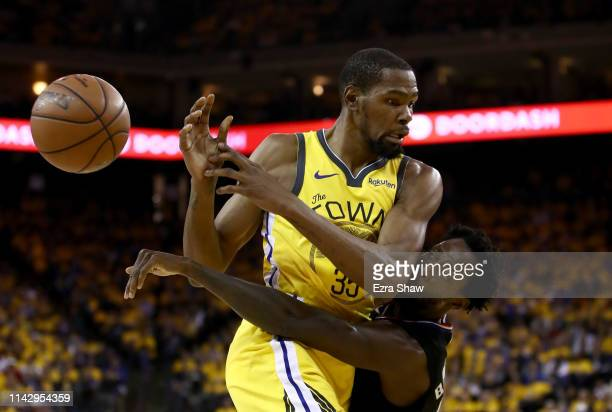 Kevin Durant of the Golden State Warriors is guarded by Patrick Beverley of the LA Clippers during Game Two of the first round of the 2019 NBA...