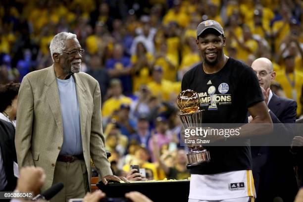 Kevin Durant of the Golden State Warriors is presented the Bill Russell NBA Finals Most Valuable Player Trophy by NBA Hall of Famer Bill Russell...