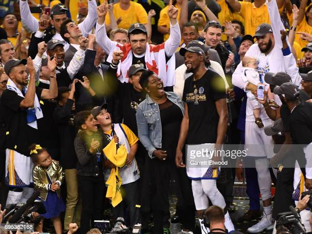 Kevin Durant of the Golden State Warriors is presented with the NBA Finals Most Valuable Player Trophy after winning the NBA Championship by...